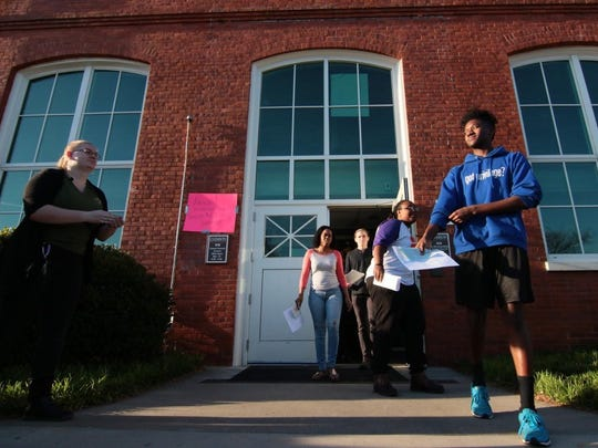 D.J. Smith (right) and four other Clemson University students are released from getting citations for trespassing in Sikes Hall, following a sit it protest. Students protested over exclusion, racial insensitivity, and administrative inaction at the university.
