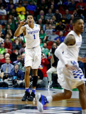 Kentucky's Skal Labissiere (#1) talks to his team as they transition to defense. Mar. 17, 2016