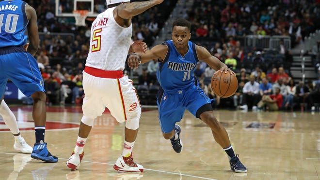 Dallas Mavericks guard Yogi Ferrell (11) drives against Atlanta Hawks guard Malcolm Delaney (5) in the second quarter of their game at Philips Arena.