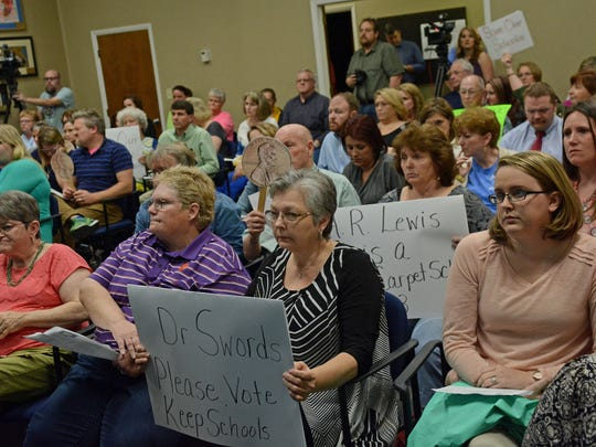 The crowd at Monday's Pickens County School Board meeting listens as board members debate closing two schools