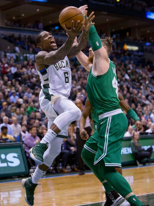 Milwaukee Bucks guard Eric Bledsoe, left, is defended by Boston Celtics center Aron Baynes, right, during the first half of an NBA basketball game Tuesday, April 3, 2018, in Milwaukee. (AP Photo/Darren Hauck)