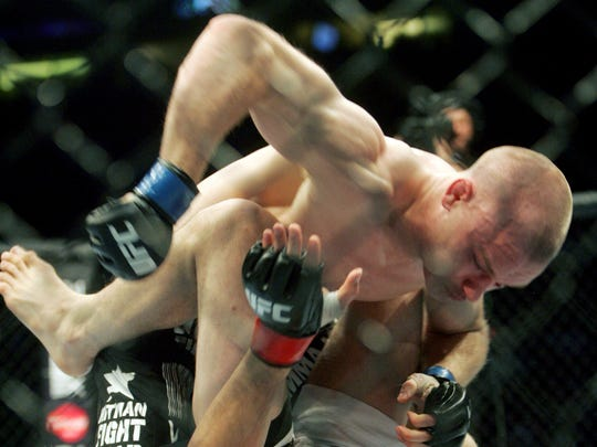 No. 9 Top 10 Sports Events: Martin Kampmann, top, hits Carlos Condit during the main event of UFC Fight Night Live April 1, 2009. The UFC visits Nashville for the first time with the Ultimate Fight Night stopping at the Sommet Center.