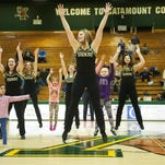 The Vermont dance team performs a routine with kids during halftime in the women's basketball game between the Albany Great Danes and the Vermont Catamounts at Patrick Gym on Saturday afternoon.