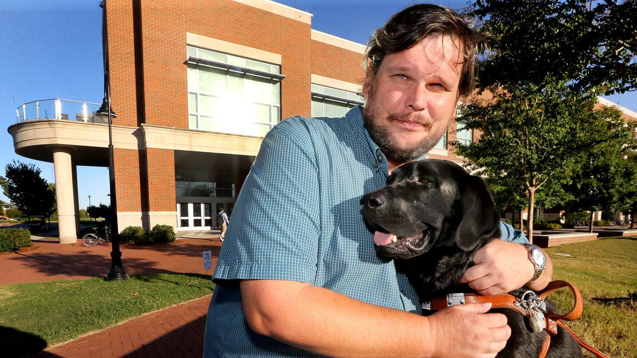 Thomas Jones and his service dog Blake were refused service and their ride was canceled leaving them stranded at the grocery store.