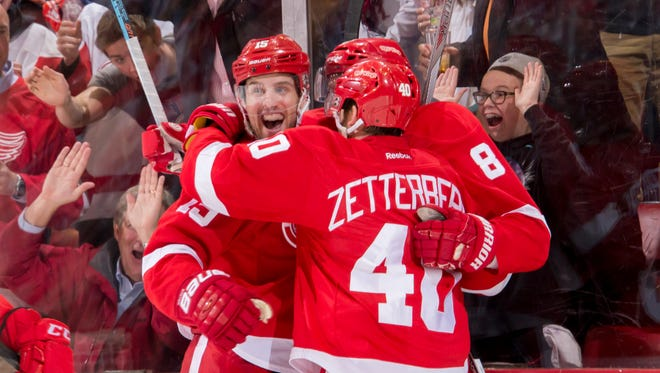 Red Wings forward Riley Sheahan, left, celebrates his third-period goal. It was Sheahan's first goal in the NHL playoffs.