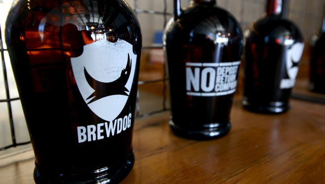 Empty growlers with BrewDog logos sit in the gift shop at the BrewDog Brewery and Taproom, in Canal Winchester in this Eagle-Gazette file photo.