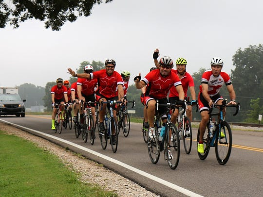 Cyclists ride through the countryside after traveling