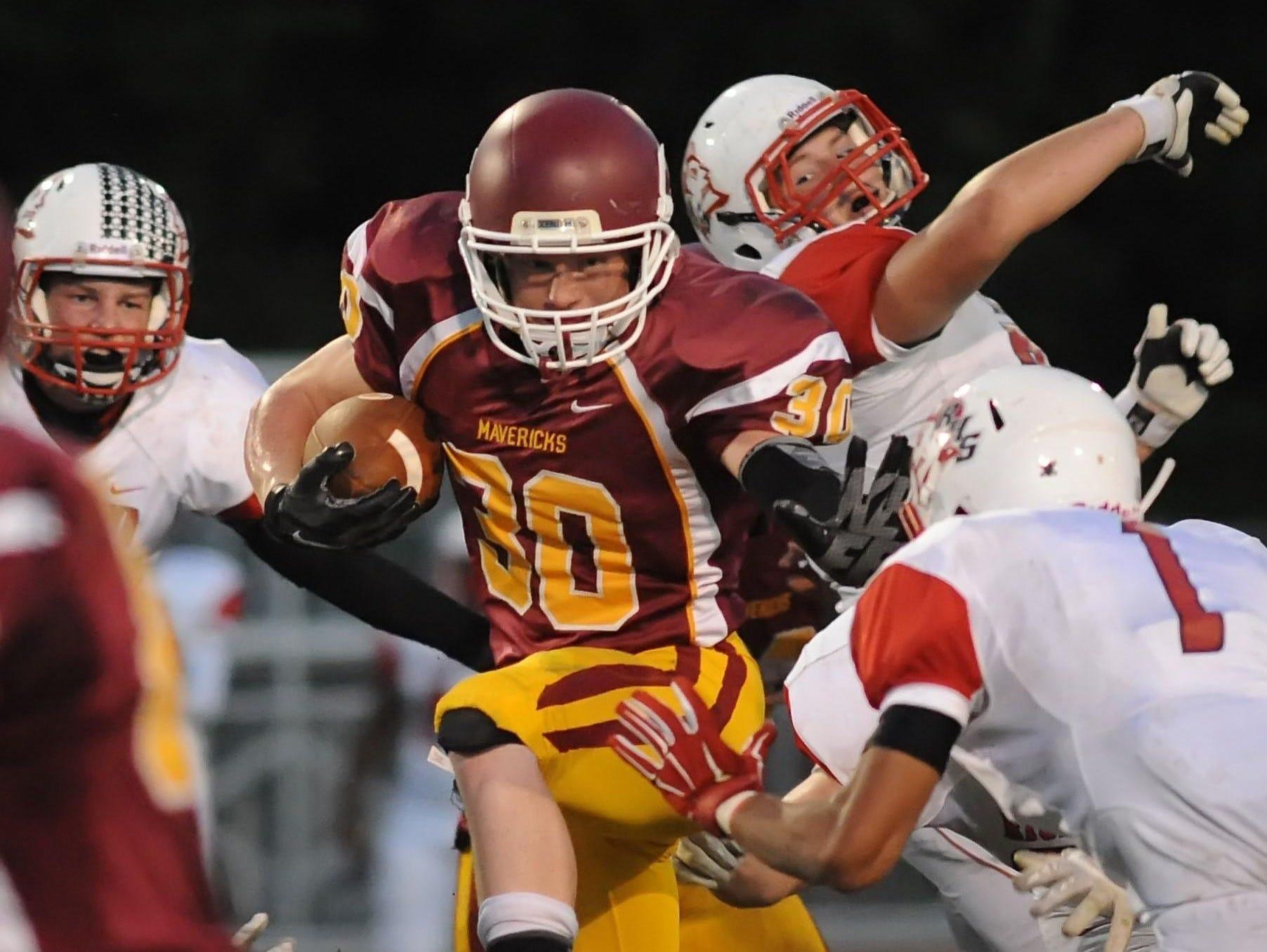 McCutcheon senior wide receiver Dakota Loveless drives downfield though Richmond defenders Friday night.