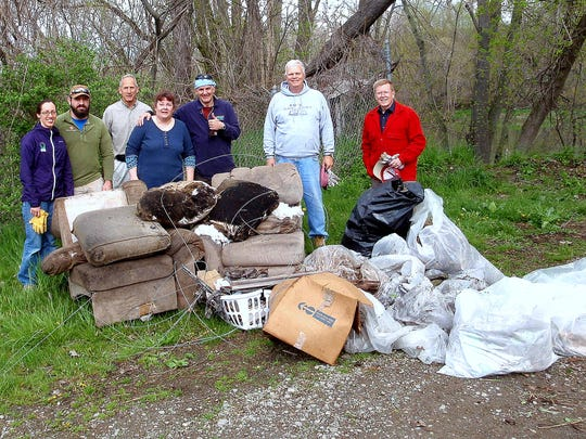 Volunteers cleaned up more than 700 pounds of trash Saturday from a Chemung River public access site.