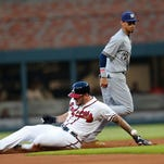 It was a tale of defensive miscues by the Brewers and defensive gems by the Braves
