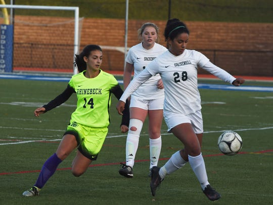 Spackenkill's Alyssa Barahona, right, winds up for a kick as Rhinebeck's Stephanie Cassens, left, defends during Monday's Section 9 Class B girls soccer final.