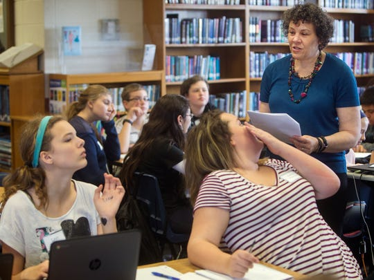 "Author April Henry conducts a writing workshop with students at Jarrett Middle School on Thursday, November 17, 2016. Every students answered a question to come up with a main character for a story. They came up with Priscilla Lee, a 6'4"", 15-year-old girl who lives with her aunt."