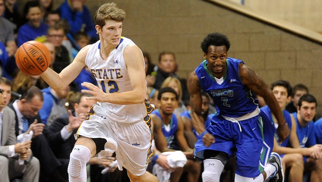 SDSU's #12 Keaton Moffitt drives down the court against FGCU's #2 Bernard Thompson during basketball action at the Sanford Pentagon in Sioux Falls, S.D., Sunday, Nov. 30, 2014.