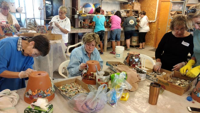 Women learn a craft, create a unique pot and benefit local charities through the class at Vicki Conley's studio.