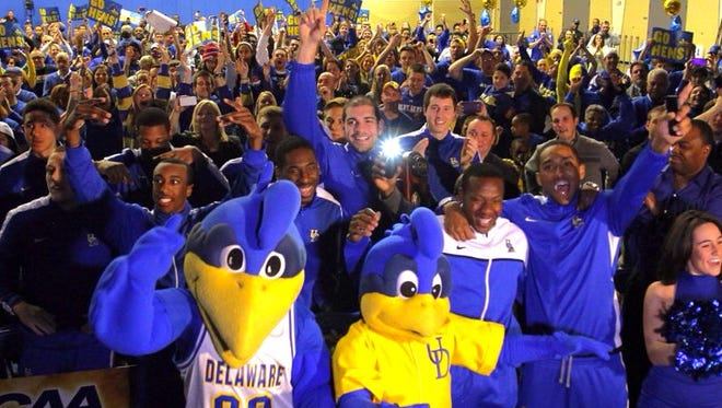 Blue Hens players and fans celebrate after finding out UD will be a No. 13 seed in the NCAA Tournament. The Hens will face Michigan State.