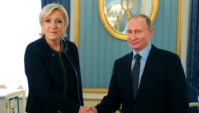 Russian President Vladimir Putin with French presidential candidate Marine Le Pen in Moscow on March 24, 2017.