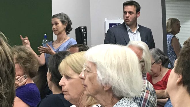 Marjorie Meyer, top left, speaks against a proposed housing project in a rural part of South Burlington at a Development Review Board meeting on Tuesday, July 17, 2018.
