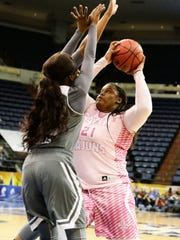 UL's  Nekia Jones drives to the basket during the Cajuns' 78- 64 loss Sunday at Lakefront Arena in New Orleans.