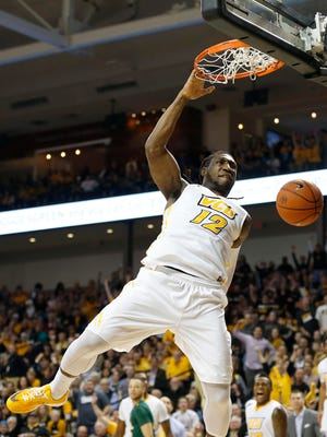 Virginia Commonwealth Rams forward Mo Alie-Cox (12) dunks the ball against the George Mason Patriots in the second half at Stuart Siegel Center. The Rams won 71-60.