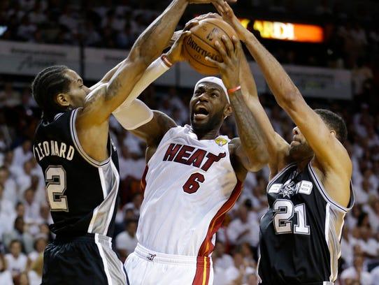 APTOPIX_NBA_Finals_Spurs_Heat_Basketball_AAA120_WEB705401