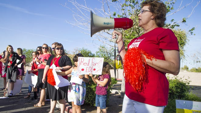 Marthana Hall, a math teacher at San Tan Charter School in Gilbert, leads chants during the state-wide teacher walk-in on April 11, 2018, in support of more educational funding.