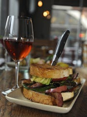 Sanjay Lillaney, the new owner of Campo, said menu changes would be decided by the culinary and front-of-house staff, not by him. Here, Campo's take on a BLT served with a Basque rosé.