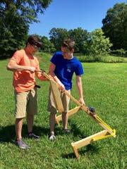 Carl Willis and Caleb Rhodes prepare their slingshot,