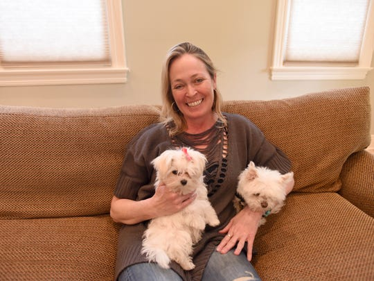 Tara McCann, who is 98 percent deaf, with her Maltese service dogs, Snoop Dawg and Ruggles.