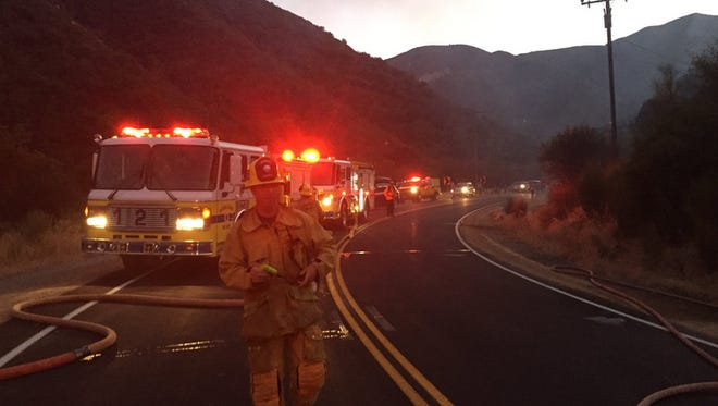 A car crash sparked a small brush fire Friday evening on Highway 33, officials said.