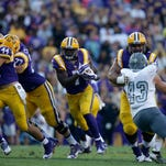 LSU running back Leonard Fournette (7) carries past Eastern Michigan linebacker Anthony Zappone (43) in the first half of an NCAA college football game in Baton Rouge, La., Saturday, Oct. 3, 2015. (AP Photo/Gerald Herbert)