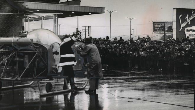 Stepping from a helicopter, Santa Claus greets a crowd at Southgate Shopping Center on S. 27th St., south of Oklahoma Ave., on Nov. 22, 1952. This photo was published in the Nov. 23, 1952, Milwaukee Journal.