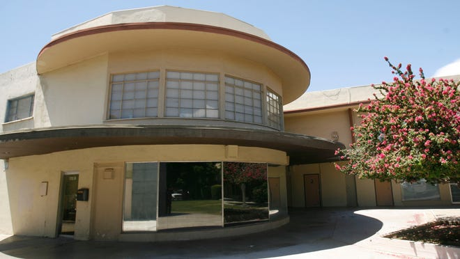 """The Town & Country Center, seen here in 2011 in the 100 block of Noth Palm Canyon Drive, was designed and built in 1948 by A. Quincy Jones and Paul R. Williams. The eraly """"mixed-use"""" development is considered one of the best examples of the international-style of architecture in southern California.On Dec. 31, 2014 the Palm Springs Preservation Foundation asked the California State Historic Preservation Office to consider adding the Town & Country Center to the California State Register, and by extension the National Register of Historic Places."""