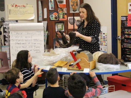 Central art teacher Rebecca Davenport demonstrates