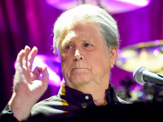 Brian Wilson signals his approval as his band plays the Ryman Auditorium in Nashville on Sept. 16, 2016.