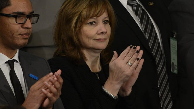 Mary Barra of General Motors listens as President Obama delivers his State of the Union speech