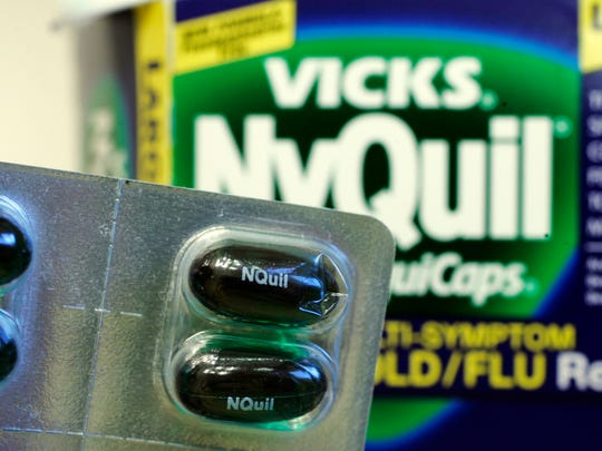NyQuil caplets is shown in a medicine cabinet at a home in Palo Alto, Calif.