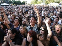 Music fans cheer on Circa Survive Tuesday, July 8, 2014, on the opening night of the Common Ground Music Festival at Louis Adado Riverfront Park in downtown Lansing.    [Photo July 8, 2014 by MATTHEW DAE SMITH | for the Lansing State Journal]