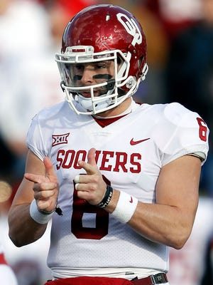 Quarterback Baker Mayfield of the Oklahoma Sooners reacts after a touchdown during the game against the Kansas Jayhawks at Memorial Stadium.