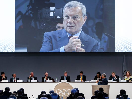 Martin Sorrell, chief executive officer of advertising agency WPP speaks at the 128th International Olympic Committee (IOC) session in Kuala Lumpur, Malaysia on Sunday, Aug. 2, 2015. Sorrell told the International Olympic Committee on Sunday that it needs to stay relevant with the younger generation and concentrate more of its content outside of the two-year Olympic cycles on the Internet and via mobile devices. (AP Photo/Joshua Paul)