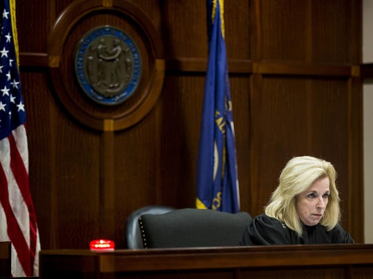 Judge Ann Ruttle listens to Ludlow Police Detective