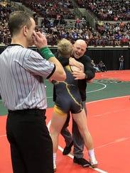 Northmor coach Scott Carr embraces Conan Becker after