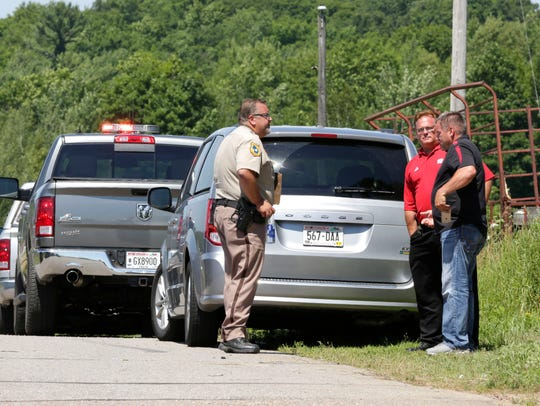 Police from multiple departments converge on the scene