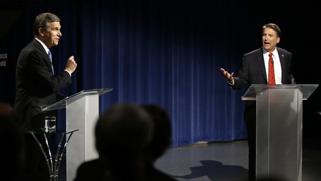 In this photo from Oct. 11, 2016, Democratic gubernatorial candidate Attorney General Roy Cooper, left, and North Carolina Republican Gov. Pat McCrory participate in a live televised debate at UNC-TV studios in Research Triangle Park. McCrory led now-Governor Roy Cooper most of Election Night in 2016 until, late at night, 90,000 votes from heavily Democratic Durham County came in. Cooper edged ahead. A final tally weeks later showed McCrory lost by just over 10,000 votes out of 4.6 million cast.