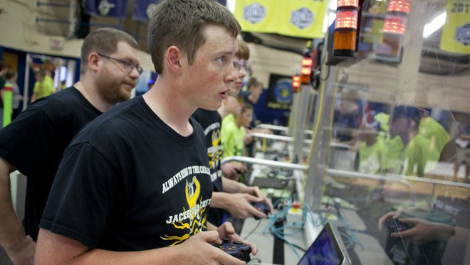 Sean Wendling from team Memphis Jacked Up Jackets 5046 controls his team's robot during the 2015 RoboFrenzy at St. Clair County Community College. The Jackets were in the runner-up alliance at a FIRST Robotics district event in Belleville.