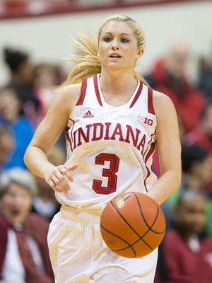 Tyra Buss brings the ball up the court against IPFW, at Assembly Hall, Dec. 20, 2014.