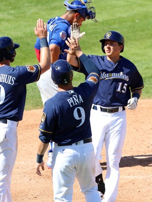 Kyle Wren is congratulated after his home run against the Cubs.