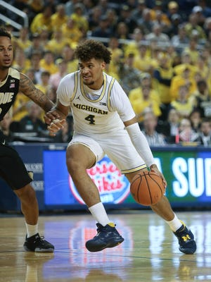Michigan forward Isaiah Livers drives against Purdue guard P.J. Thompson during the second half of U-M's 70-69 loss on Tuesday, Jan. 9, 2018, at Crisler Center.