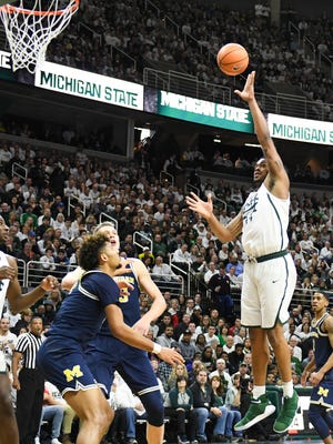Nick Ward scores during the first half against UM Saturday, Jan. 13, 2018, at the Breslin Center in East Lansing.