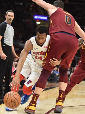Ish Smith drives into Cavaliers forward Kevin Love on Jan. 28 in Cleveland.