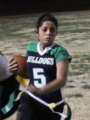 Running back Elizabeth DeLeon gets out of the end zone